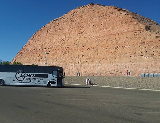 Echo transporting a group tour, stopping to admire the a unique rock formation in Orderville, UT